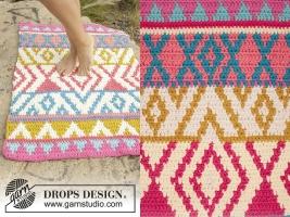 Вязаный коврик с цветным рисунком от Drops